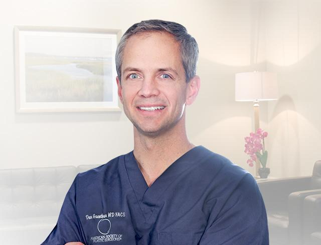 Dr. Dax Guenther smiling with his arms crossed