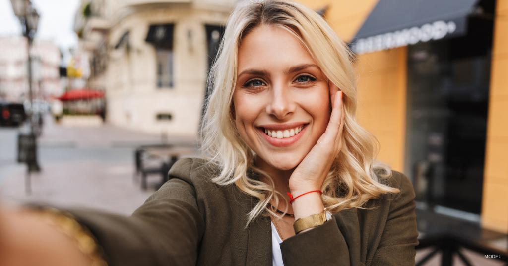 Woman taking a selfie for Instagram
